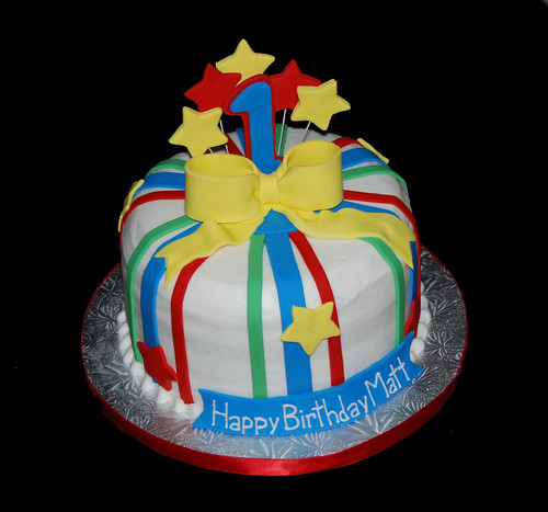 1st birthday red blue yellow and green birthday cake