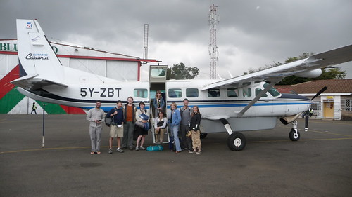 Day 4: Group shot by our little plane