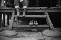 The Photographer (damak) Tags: ilfordhp5 filmcamera rodinal leicam7 malayhouse standdevelopment traditionalmalayhouse zeissbiogon woodenstair