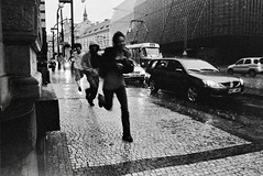Running away from the rain - Prague (Dr Karanka) Tags: street blackandwhite cars film day prague praha ilfordhp5 czechrepublic rodinal 400asa heavyrain primelens asahipentaxsp2 peoplewithoutumbrellasrunningawayfromtherain fds24hdrkaranka