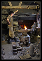 Blacksmith (Roger.C) Tags: hammer museum wales work canon fire welsh 1855mm blacksmith trade making stfagans anvil mending 30d abigfave