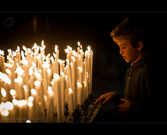 (Yug_and_her) Tags: light boy italy church candles christ praying tourist offering diwali attractions duomodimilano lombardy juesus milancathedral