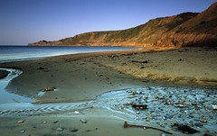 Runswick Bay (mattneighbour) Tags: cliff film beach photoshop 35mm landscape fuji minolta yorkshire velvia 135 goldenlight runswickbay dynax7 sigma18to35mmf3point5to4 sekonicl558 compositeofmultiplescans copyrightmneighbour2007allrightsreserved interestingness2007