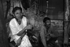 DSC_1073 (Tanja on flikr) Tags: 2005 bw india smoking rickshaw kolkata puller westbengal black38white