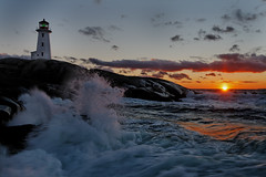 Question : Here is a non-HDR version of my Peggy's Cove Lighthouse II photo, which do you prefer ? (iJohn) Tags: ocean blue light sunset sea lighthouse canada rock waves novascotia cove wave peggyscove supershot abigfave wbnawcnns