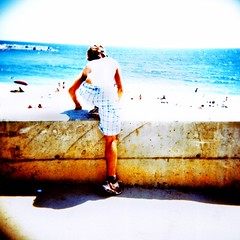 ...e io mi butto (ale2000) Tags: barcelona boy sea people beach wall mediumformat square holga jump xpro sand mare cross crossprocess bcn playa photowalk process spiaggia barcellona fuji64t