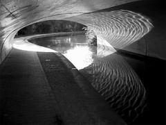 Light Ripples (tetradite) Tags: uk bridge england blackandwhite bw white black reflection blancoynegro monochrome digital canon canal noiretblanc ripple ixus desaturated coventry schwarzweiss towpath lght pointandclick 10faves monochromia