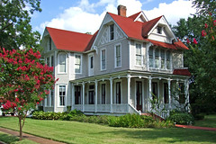 Red Roof (Texas Finn) Tags: windows sky house detail home beauty architecture clouds texas post steps lawn victorian front historic porch crepe myrtle mansion posts gables trim frontporch railings gable crepemyrtle easttexas rusk redroof wraparound wowiekazowie preseration twosstory