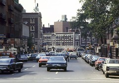 Entering Harvard Square, 1972 (AntyDiluvian) Tags: harvardsquare harvard 1970s scanned 70s massachusettsavenue massave subwaystation 1972 coop thecoop subwayentrance signs closed moved replaced brattlestreet harvardcameras ferrantedege harvardbarbershop pewterpot yardofale niniscorner