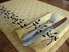 Maize Napkins and Placemats with Black Leafy Print