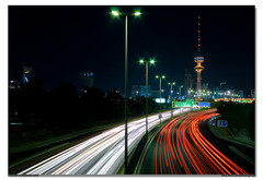 Streaks and Tower (Mishari Al-Reshaid Photography) Tags: longexposure art night canon eos photo nightshot nightphoto kuwait 1855mm digitalrebel canoneos kuwaitcity q8 grendizer slowshutterspeed lightstreaks artphoto vwc carsatnight xti 400d mishari mywinners digitalrebelxti  kuwaitphoto kuwaitatnight kvwc kuwaitartphoto kuwaitart  kuwaitvoluntaryworkcenter kuwaitvwc kuwaitafterdark misharialreshaid malreshaid misharyalrasheed