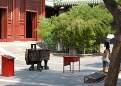 kneeling (immu) Tags: china travel temple praying beijing buddhism lama kneeling insence yonghegong lamaism