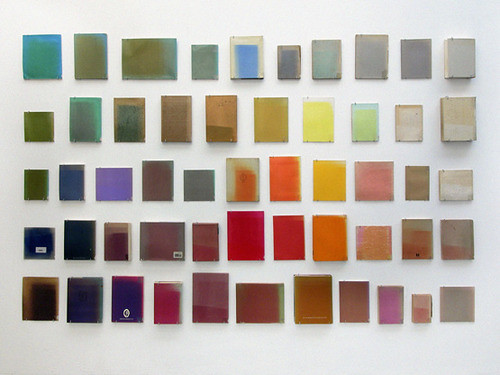 Marianne Vierø — Out of Order #1. Sunbleached library books mounted on a wall.