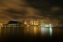 Marina Bay (tatographer ) Tags: travel reflection building colors night marina buildings landscape lights bay harbor nikon singapore nightshot horizon scenic structures places structure d200 tato nikond200 longx tatoistic tatosphere alvinsantiago tatography tatographer