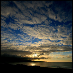 Evening light over St Ives, Cornwall #3 (Altocumulus) (s0ulsurfing) Tags: ocean blue light sunset shadow sea sky cliff cloud sun sunlight seascape beach nature water beautiful weather silhouette clouds wow evening bay coast amazing twilight cornwall waves skies sundown natural bright wind shots dusk cove patterns wide shoreline wideangle cliffs formation coastal shore coastline swell stives depth 2007 altocumulus gwithian hayle 10mm beachbreak westcornwall sigma1020 supershot instantfave s0ulsurfing thecloudappreciationsociety superaplus aplusphoto theunforgettablepictures