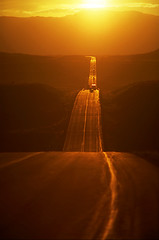"Highway into the sunset (IronRodArt - Royce Bair (""Star Shooter"")) Tags: road trip travel light sunset summer orange sun sunlight inspiration abstract mountains color up yellow rural sunrise way landscape gold freedom drive moving highway driving escape view traffic desert outdoor infinity horizon country transport perspective scenic dramatic fast down hills route direction journey transportation freeway destination continuity straight asphalt"