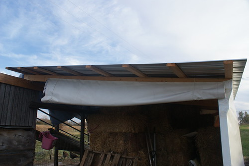 Roll up hay shelter door