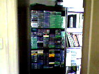 VHS tapes on a bookcase