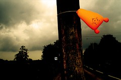 Balloon. (DJ Bass) Tags: road orange clouds catchycolors dark balloons landscape grey tiger balloon pole odd poles unplugged