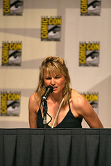Lucy Lawless finds her chair wet