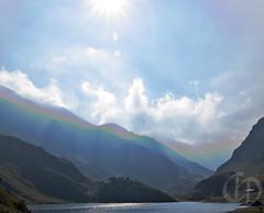 Fake reversed rainbow (PsychoWood) Tags: blue sky sun mountain lake landscape lago rainbow blu cielo lensflare flare sole montagna riflesso diga vallidilanzo malciussia lagoartificiale valdivi maciaussia