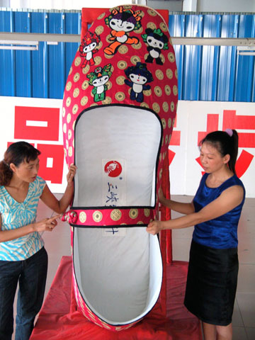 Huge hand-made shoe bearing the mascots of the Beijing Olympic Games
