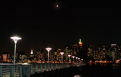 Moon Over the East River NYC (jackie weisberg) Tags: city nyc newyorkcity urban moon ny newyork vertical skyline night buildings image sightseeing cities cityscapes queens photograph nightime promenade eastriver empirestatebuilding newyorkstate northeast longislandcity nys thebigapple colorimage promenades viewfromlongislandcity jackieweisberg