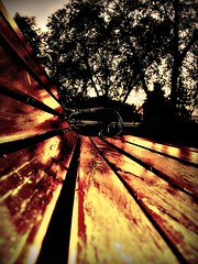 wooden fire (vereiasz) Tags: park sunset orange bench wooden perspective 100v10f explore saturation fv10 glowing sunlit itasca chicagoillinois takeabow woodenbench superbmasterpiece woodenfire