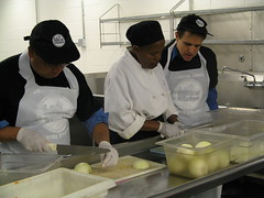 Congressman Ellison chopping onions at a DC soup kitchen