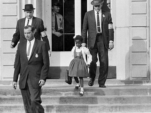 U.S. Deputy Marshals escort 6-year-old Ruby Bridges from William Frantz