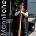 Mannlichen,Switzerland - A statue of a farmer blowing a Swiss Alpenhorn stands at the entrance to the cable car station