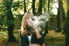 cigarette smoke (Ann Evergreen) Tags: tree fall film girl leaves cigarettesmoke