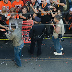 Andres Torres with fans at San Francisco Giants World Series parade thumbnail
