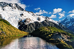 Alpine tarn (Daniel Murray (southnz)) Tags: blue newzealand sky mountain lake snow reflection ice rock landscape nationalpark scenery mt cook glacier mount alpine nz southisland tarn tussock footstool aoraki sealy tarns southnz eos50escanfromprint