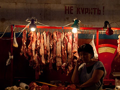 Meat seller in Osh bazaar (Evgeni Zotov) Tags: city light red people food woman lamp mobile wall dark town asia phone market smoke talk meat balance kyrgyz bazaar sell russian kyrgyzstan trade marketeer merchant seller inscription trader bishkek oshbazaar kirghizistan kirgistan kirgizia kirgizistan kirgizië kirgisistan oshmarket قيرغيزستان kirguistan kirghizia kırgızistan quirguistão киргизия бишкек кыргызстан 吉尔吉斯斯坦 吉爾吉斯斯坦 キルギスタン 키르기스스탄 किर्गिज़स्तान קירגיזסטן