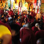 Activity, Passing out long life rise and tea from metal pails to the lamas, monks, nuns, and other Dharma practioners, Tharlam Monastery of Tibetan Buddhism, Boudha, Kathmandu, Nepal thumbnail