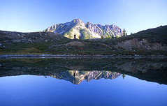 Reflecting... (justb) Tags: morning blue people woman mountain lake mountains reflection colors beautiful person reflecting scenery colorful bc scenic reflect alpine figure tarn blueribbonwinner outstandingshots outstandingshot anawesomeshot