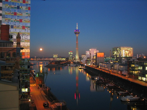 Full moon over Düsseldorf Medienhafen by Dirk Hartung.