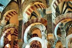 Arches in the Mezquita with Latin overlay (George Reader: Thank you for 300,000 views) Tags: architecture spain christian spanish moorish cordoba mezquita domes moslem chathedral corboda