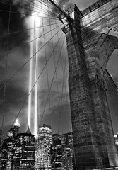 WTC tribute in lights over Brooklyn Bridge (noamgalai) Tags: nyc bridge light cloud white ny newyork black brooklyn night photography lights photo memorial downtown remember worldtradecenter bricks towers battery picture twin laden september beam photograph terror wtc tribute september11 sept allrightsreserved globalvillage   photomania  noamg tributeinlights noamgalai    globalcity invitedphotosonly gvadminshalloffame itsabeautifulgv wwwnoamgalaicom
