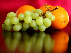 Fruit Salad (Mukumbura) Tags: red food orange brown reflection green fruit table salad tasty grapes citrus oranges fruitsalad