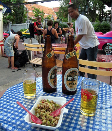 Green banana salad with beer and a backpacker's view