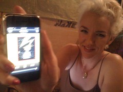 Xeni with Bad Brains on her iPhone