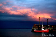 Red Boat (Dave G Kelly) Tags: ireland red sea sky cloud galway clouds coast harbor pier boat fishing harbour connemara fishingboat trawler irlanda irlande redboat thebigone  irlandia 2for2  25faves p1f1 aplusphoto   superhearts potwkkc44  davegkelly
