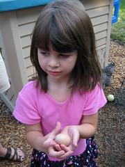 Hannah holding Sophia's first egg