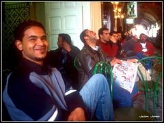 Tunis-Medina-1.jpg (jjay69) Tags: men smile laughing dark newspaper chair northafrica tunisia teeth muslim islam tunis bank read grin medina smirk brotherhood islamic muslimcountry