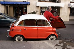 Romi Isetta (micmol ) Tags: red white man argentina argentine car horizontal america alone south small 4 wheels entrance plate nobody front iso latin bmw driver hispanic economy romi compact salta isetta 787 xba