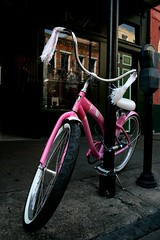 Hello Kitty (Stacey Warnke Photography) Tags: hello pink reflection bike bicycle wheel cat la louisiana post hellokitty parking neworleans lion kitty tire tires sidewalk frenchquarter decatur meter parkingmeter tassels likeitornotchallenges