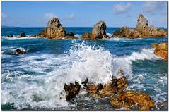 Splash - malaysia sibu island (fiftymm99) Tags: beach nikon rocks wave malaysia sunnyday rockformation bigsplash fiftymm nikond300 southchinaocean fiftymm99 malaysiatourismboard sibuislandmalaysia
