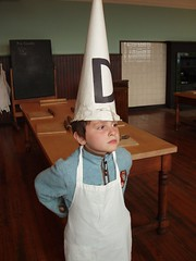 A dunce cap is still culturally relevant when referencing idiocy, right?